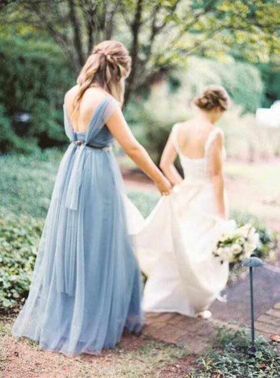 White Bride and dusty blue bridesmaids for dusty blue March wedding