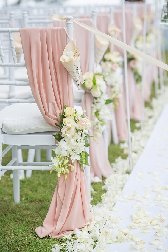 aisle decor with dusty rose drapes and white and yellow flowers for spring dusty rose wedding