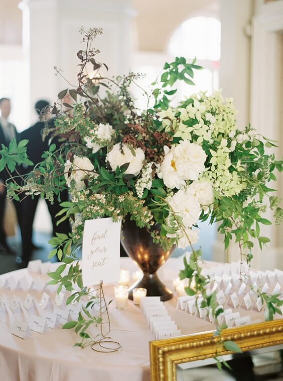 green and white flower centerpiece for spring dusty rose wedding