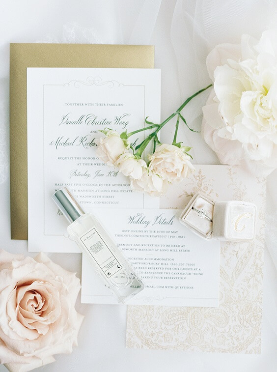 white invitation and pale pink flowers for spring dusty rose wedding
