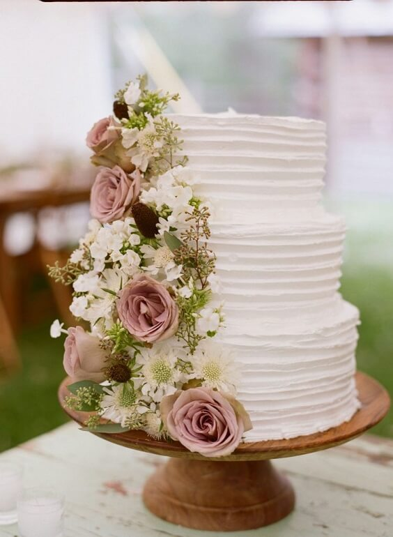 white wedding cake with garden roses for spring dusty rose wedding