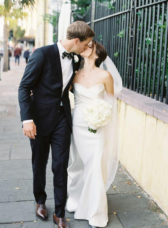 White bride and blue groom for Emerald Green and Blue Fall wedding