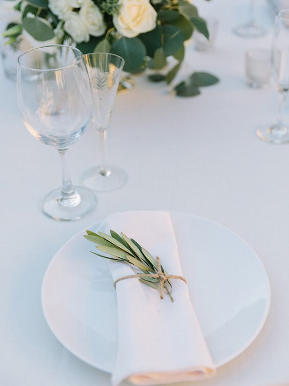 cream tablecloth and white plate setting for spring ice blue wedding