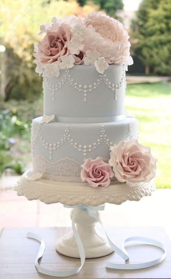 ice blue wedding cake with pink flowers for spring ice blue wedding 2