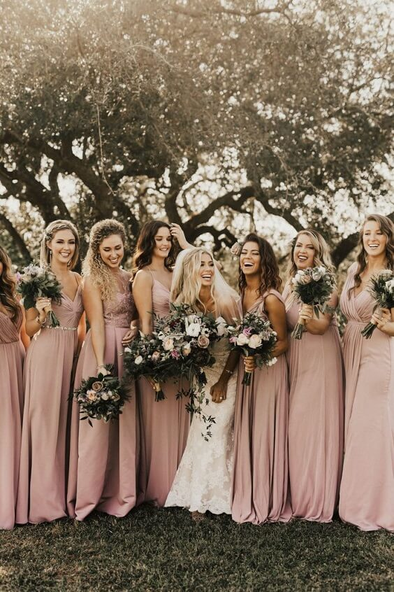 dusty rose bridesmaid dresses and sage green bouquets for fall boho chic dusty rose wedding