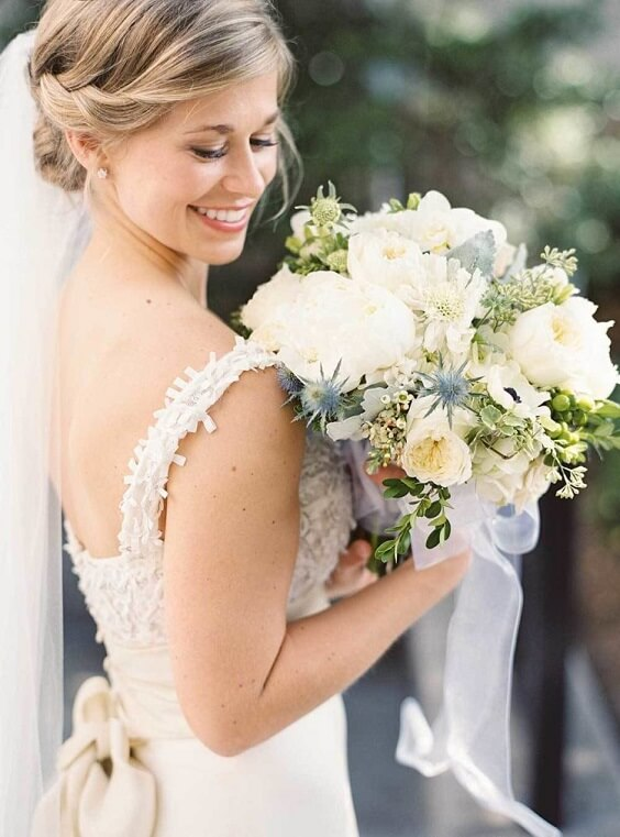 bride with bouquets for spring dusty blue wedding