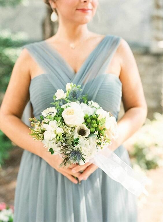 dusty blue bridesmaid dresses paired with bouquet for spring dusty blue wedding