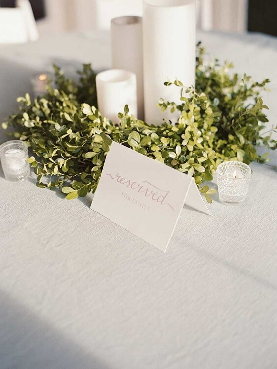 white candles and table number card with greenery decorations for spring dusty blue wedding