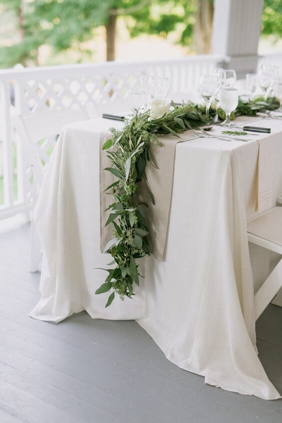 white table runner with greenery for spring dusty blue wedding